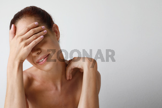 Portrait of cheerful mature woman posing over white wall. Anti-aging. Isolated.