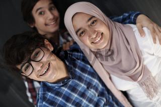 group of arab teens taking selfie photo on smart phone