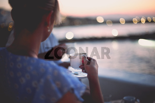Couple drinking tea on shore in evening