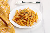 Food - Delicious Penne Pasta Plate with a Fork on White Marble Background