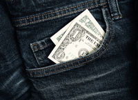One dollar banknote in a jeans pocket