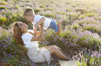 Happy young mother and her little in lavender field