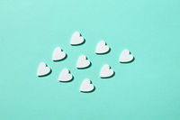 Handmade paper hearts pattern with hard shadows.
