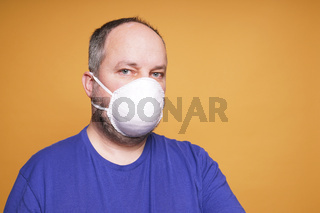 person with face mask or dust mask or filtering facepiece respirator or breathing protection