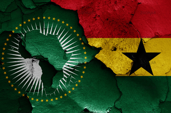 flags of African Union and Ghana painted on cracked wall