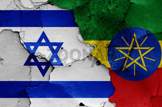 flags of Israel and Ethiopia painted on cracked wall