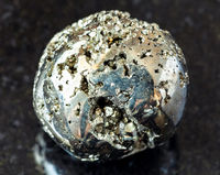 tumbled Pyrite ( fool's gold) rock on black