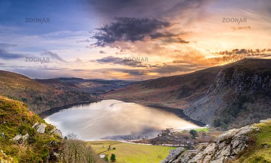 Dramatic sunset at Lake Lough Tay or The Guinness Lake in County Wicklow