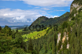 Green meadow among mountains in Bavaria, Germany.