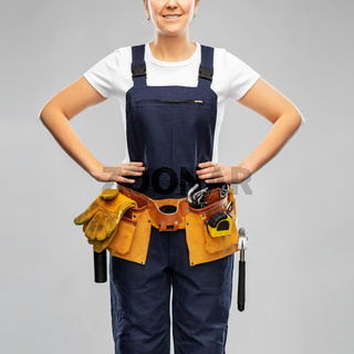 female worker or builder with working tools