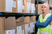 Islam Muslim female warehouse worker portrait in warehouse