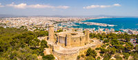Aerial drone view of Palma de Mallorca city. Cityscape with view on Bellver castle, sea, marina, architecture. Majorca, Balearic Islands, Spain