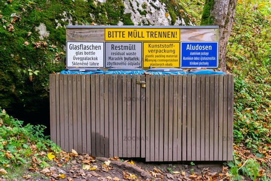 Waste container in the forest. German words Bitte Müll trennen means Please separate rubbish