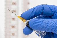 vaccination with serum and syringe against COVID-19 virus
