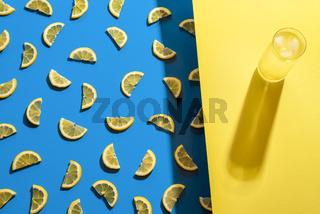 Glass of lemonade and lemon slices pattern. Summer cold drink