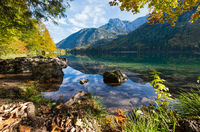 Peaceful autumn Alps mountain lake with clear transparent water and reflections. Langbathseen lake, Upper Austria.