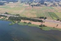 Aerail view Dutch rural landscape with mototway along lake IJsselmeer
