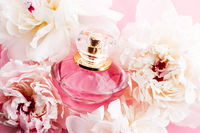 Luxurious fragrance bottle as chic perfume product on background of peony flowers, parfum ad and beauty branding