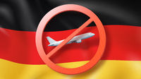 Prohibition sign with crossed out plane on the background of German flag.