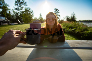 Two people having a warm drink outdoors