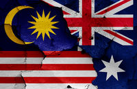 flags of Malaysia and Australia painted on cracked wall