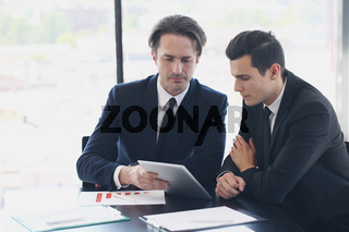 Two business men looking at tablet