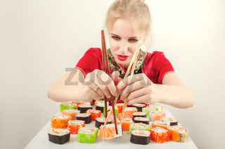 fun girl with sushi on white background
