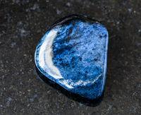 tumbled Dumortierite rock on black