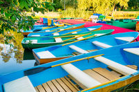Row of colorful boats at pier