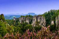 Saxon Switzerland landscape un Germany with its sandstone cliffs and mountains at dusk