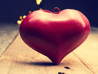 Red heart shape on a wooden table