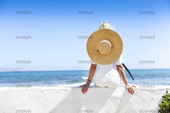 Young happy blond woman at beautiful tropical paradise view of ocean enjoying summer holidays
