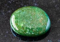polished green Aventurine gem stone on black