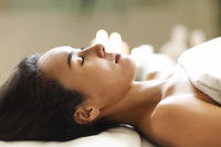 Asian woman resting during spa procedure