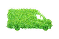 Isolated delivery van made of leaves. Electric cargo car, transportation and environmental concept