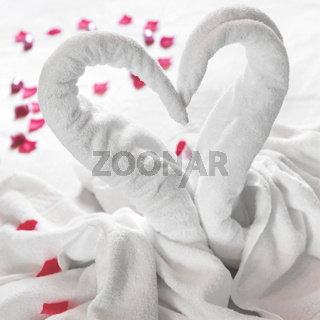 Towel swans on the bed