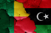 flags of Benin and Libya painted on cracked wall