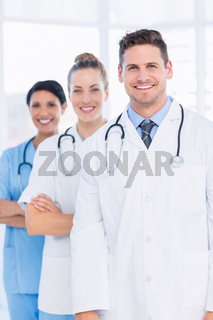 Confident happy group of doctors at medical office