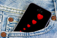 Smartphone with red hearts on the screen