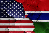flags of USA and Gambia painted on cracked wall