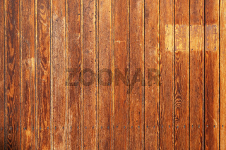 old rustic wood paneling background with vertical wooden boards