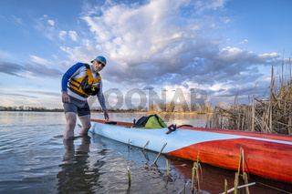 solo senior male stand up paddler