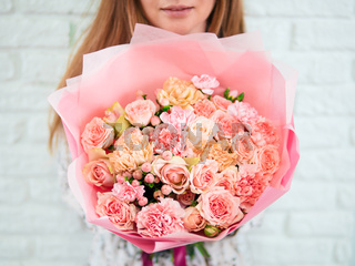 Pink bouquet in woman hand