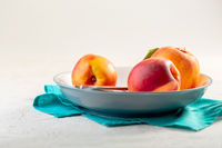 Three ripe nectarines. Concept of healthy eating.