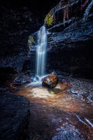 Waterfall tumbles in a small canyon in Blue Mountains