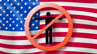 Warning sign with crossed out man on a background American flag.