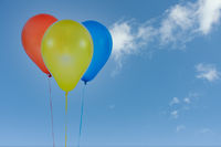 Colorful balloons for birthday and celebrations isolated at blue sky