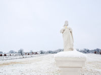 Statue on a waycross in Burgenland with snow