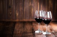 Red wine glasses on wood