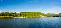 Wide panorama of Cheat Lake on a summer evening with boats docked in marina